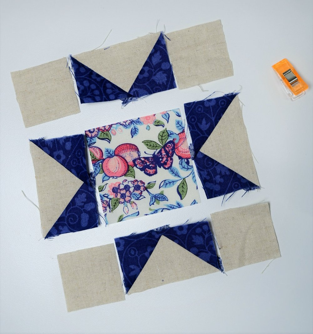 "Lay out your star and sew together the 3 pieces in each row using a 1/4"" seam allowance and roll open your seams."