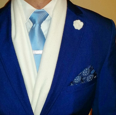 Channel Jack Frost in an ice blue tie, white scarf and snowflake pocket square