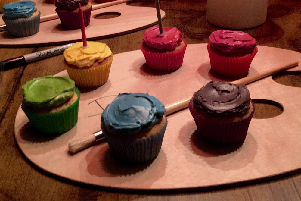 An painter's  palette  makes a great display for birthday cupcakes.