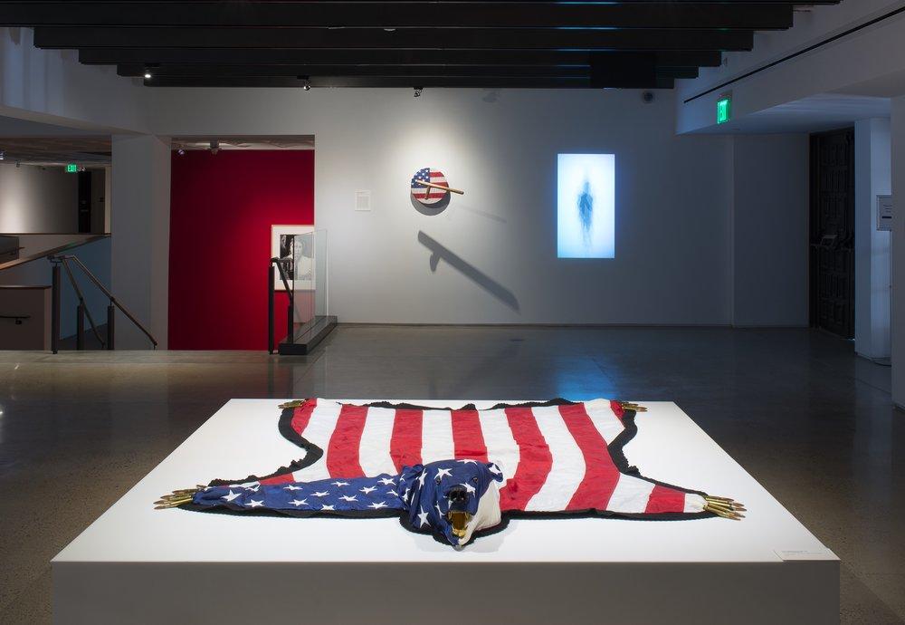 The American Dream is Alie and Well,  U.S. flag, .50-caliber ammunition, foam, gold leaf, plastic, 2012.