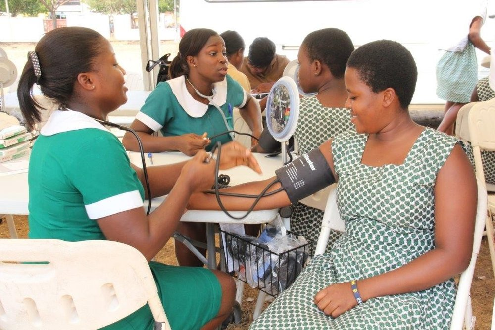 Healthcare workers in Ghana, tend to patients: Photo Credit:  OPIC