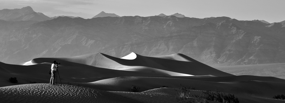 A landscape photographer at the sand dunes of Death Valley, California.jpg