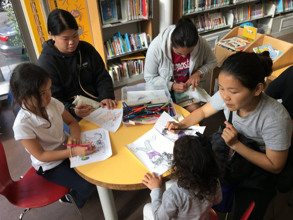 Moms join in with the coloring at the library!