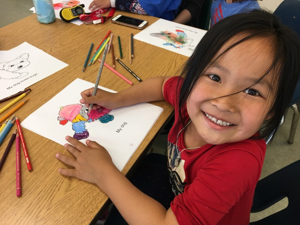 A student colors my story 'My Dog Henry' at TelHi