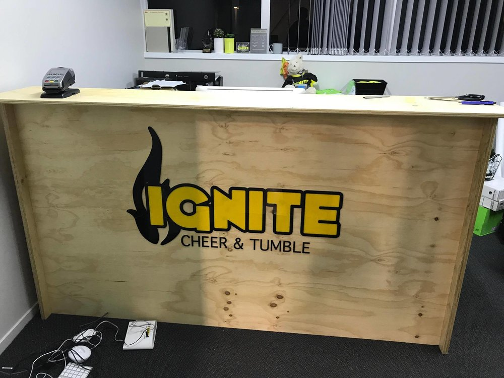 Ignite Cheer & Tumble reception desk signage