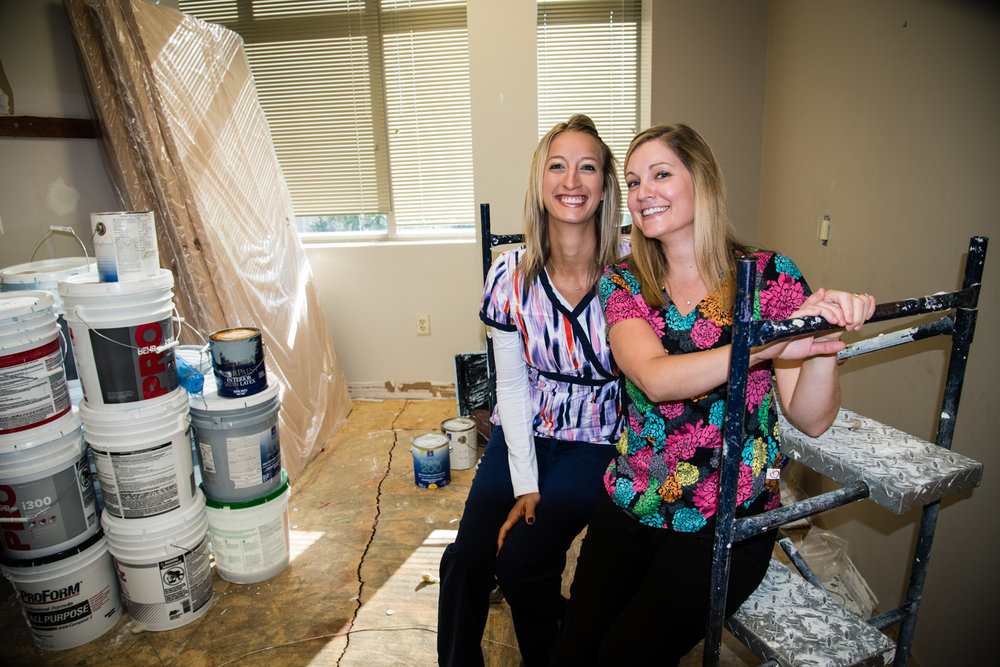 Katie and Tina pose in a future exam room and are hoping the floors are done soon!