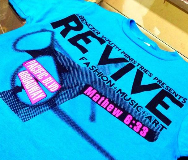 Fashion Tee with Revive design on it