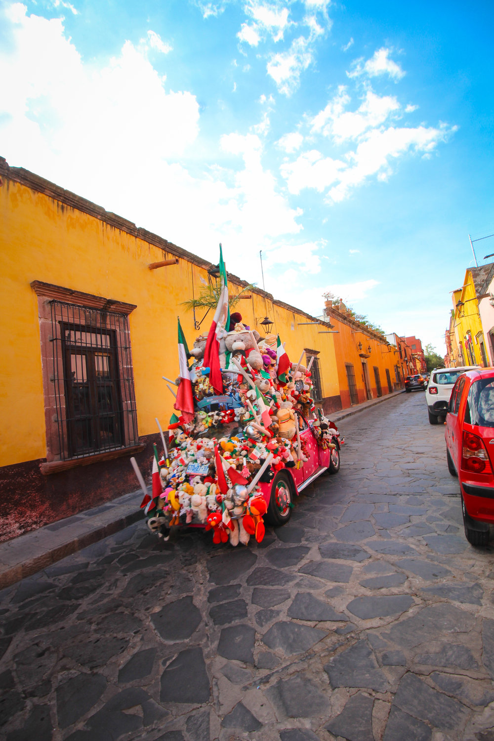 Random car with TONS of plush on it driving around San Miguel De Allende