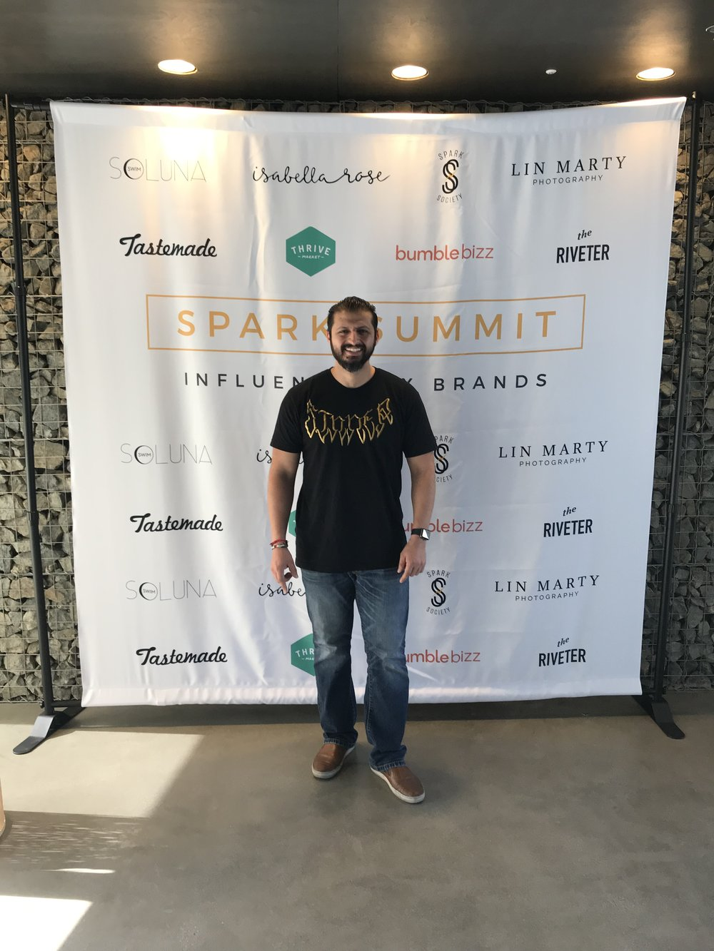 Me at the Spark Summit backdrop