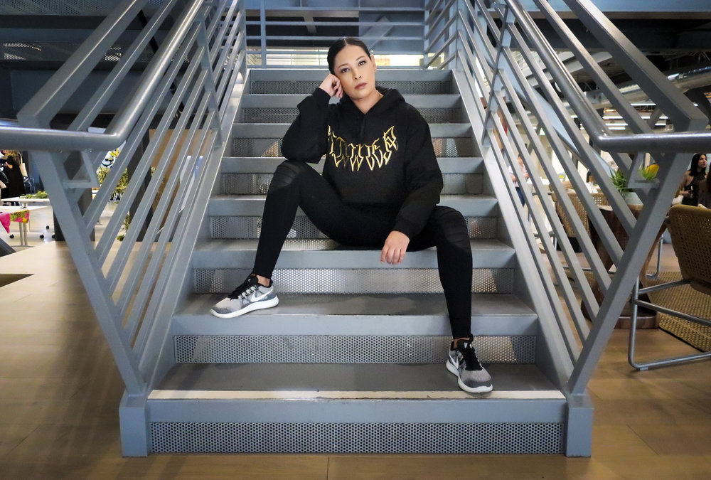 Betsy Correa wearing the SINNER Hoodie at The Spark Summit