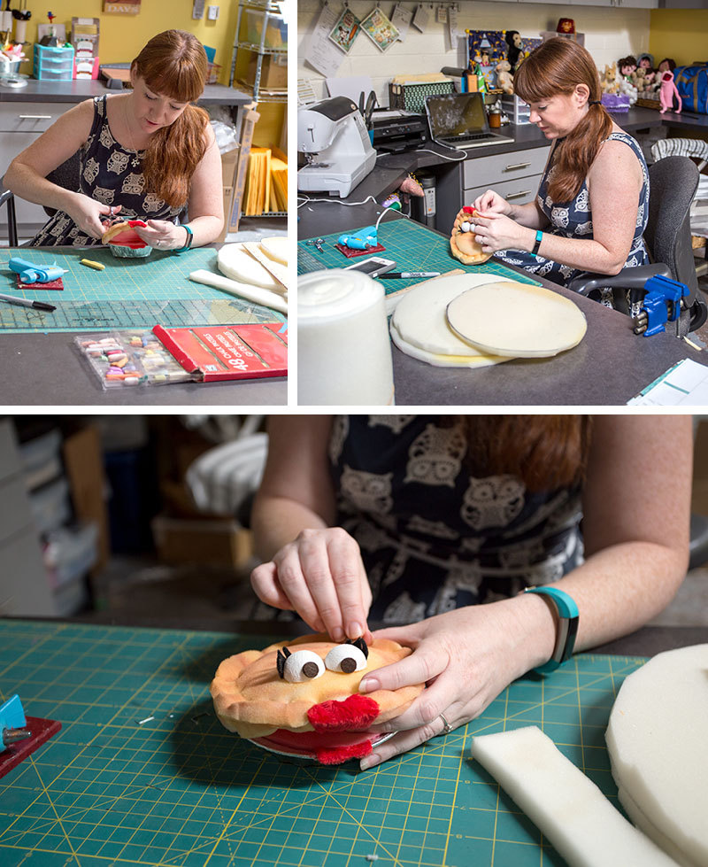 "Stacey gets creative working on a custom order for ""a lady pie,"" with eyelashes and lipstick. Working with foam as a base, she carves out the shape of the puppet, sews and glues on fabric and eyeballs and uses chalk pastels to add shading and dimension. ""It's going to be glorious,"" Stacey says."