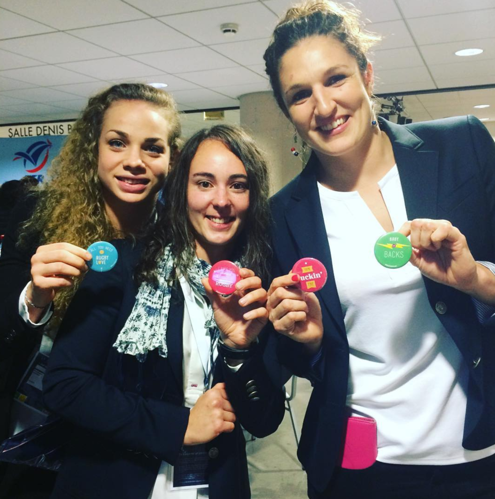 We sent some swag over to France with the USA Women's Eagles for their fall tour. Here's the French scrumhalf, lock, and wing reppin' some buttons.