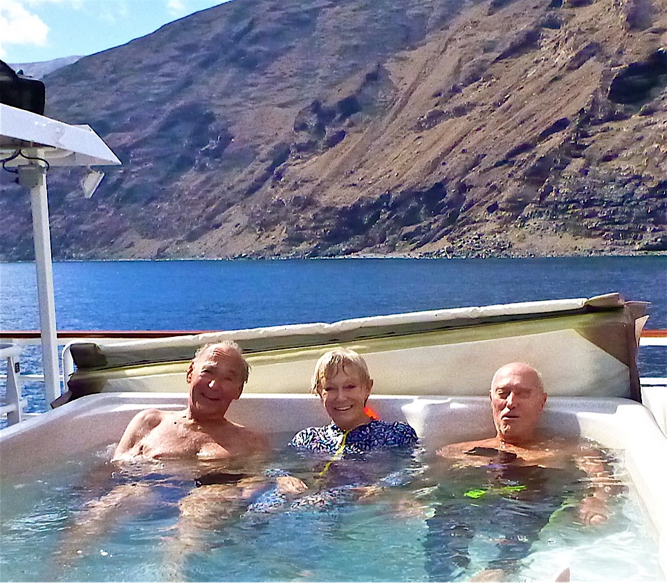 Ernie, Val Yaylor and Stan Waterman in the hot tub after a shark dive.