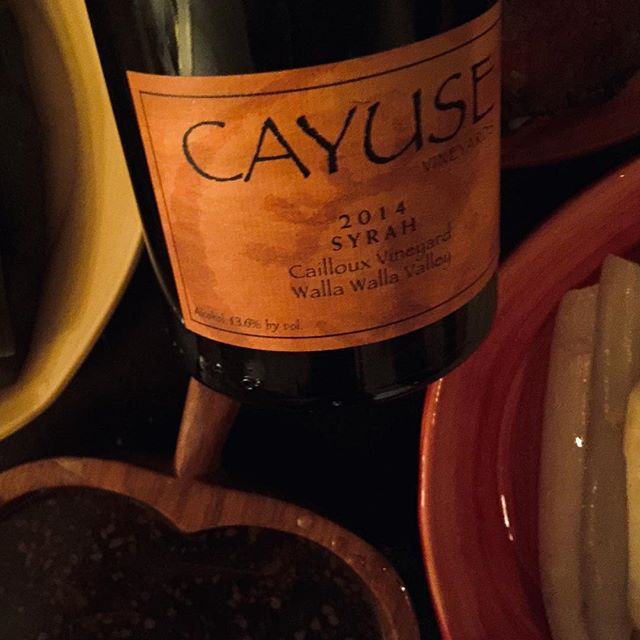 #cayusevineyards #2014syrah #caillouxvineyard #washingtonwine #redwinelover #redwine #winelover #cheers 🍷  100 point wine by Robert Parker, ok let's taste it. Not opaque in the least- deep youthful ruby. 'Sauvage' nose so typical of Cayuse-bloody, savoury, sweaty, mineral laden with a limited use of new wood. Bright with a beam of bright raspberries mingling in with touch of distinct apricots( 7% Viognier added gives a Côte Rôtie feel). Complex aromas of bacon, liquorice, hung game, gingerbread, chocolate flakes, exotic spices, road tar and raw opium abound. On the palate after opening the wine continually gained impressive weight becoming ultimately full-bodied with a sturdy, powerfully built tannic structure sitting below. Rich yet never heavy, excellently balanced with a wonderful sense of freshness. Alcohol is hidden beneath the wealth of fruit and the wine remains constantly lively and long in the mouth. This wine again shows huge amounts of mineral driven fruits and is like sucking on juice drenched rocks in the sun. Lovely purity and complexity in this wine- will drink for 10 or 15 years.