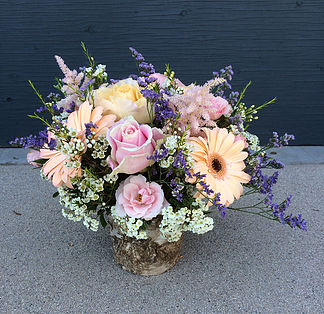 Roses & Gerberas Arrangement   Comes in standard, deluxe, and supreme variations. Please call for prices and additional information.  $75.00