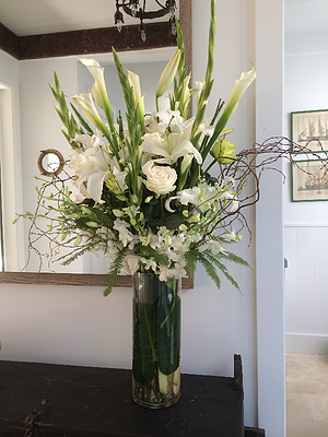 Tall Classic White & Green Arrangement   Comes in standard, deluxe, and supreme variations. Please call for prices and additional information.  $100.00