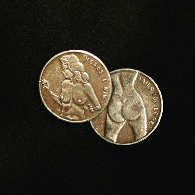 Heads I win. Tails you lose. My grandfather's risqué decision coin from the '50s.