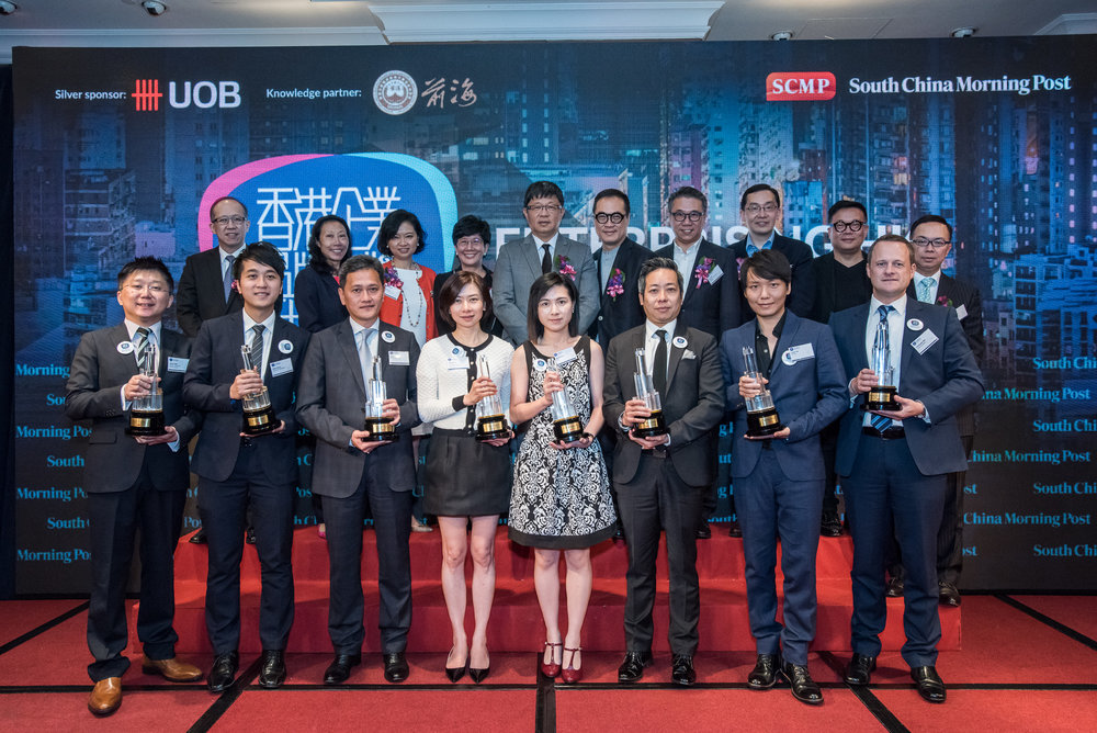 The Enterprising Hong Kong Brand Awards 2016 winners include (front row, left) Mr Jacky Kwan, Chairman, Bamboos Professional Nursing Services; Mr Alfred Wong, Area Manager of Tung Fong Hung; Mr Sammy Kam, Technical Director of Octopus Cards Ltd.; Ms Winnie Ho, Head of Branding and Marketing Communications of 3 Hong Kong; Ms Annis Chung, Administrative Officer of 4M; Mr Patrick So, General Manager of Arome Bakery HK Co Ltd.; Mr Leslie Fok, Marketing Director, D2 Place; Mr Christopher Birt, General Manager, Inflight Services of Hong Kong Airlines. The Enterprising Hong Kong Brand Awards 2016 are supported by an esteemed judging panel including (back row, left) Mr Gordon Lo, Director, Business Management of Hong Kong Productivity Council; Ms Enoch Yiu, Chief Reporter of the South China Morning Post; Mrs Christine Ip, Managing Director and CEO, Greater China of United Overseas Bank Limited; Professor Angelina Yuen, Vice President (Student and Global Affairs) of The Hong Kong Polytechnic University; Mr Robin Hu, Chief Executive Officer, South China Morning Post Publishers; Mr Raymond Ho, Chairman of The Hong Kong Advertisers Association; Mr Eric Yim, Deputy Chairman of the Federation of Hong Kong Industries; Dr Edmund Lee, Executive Director of Hong Kong Design Centre; Mr Spencer Wong, Chairman of The Association of Accredited Advertising Agency of Hong Kong and Mr Stephen Liang, Director of Product Promotion of HKTDC.