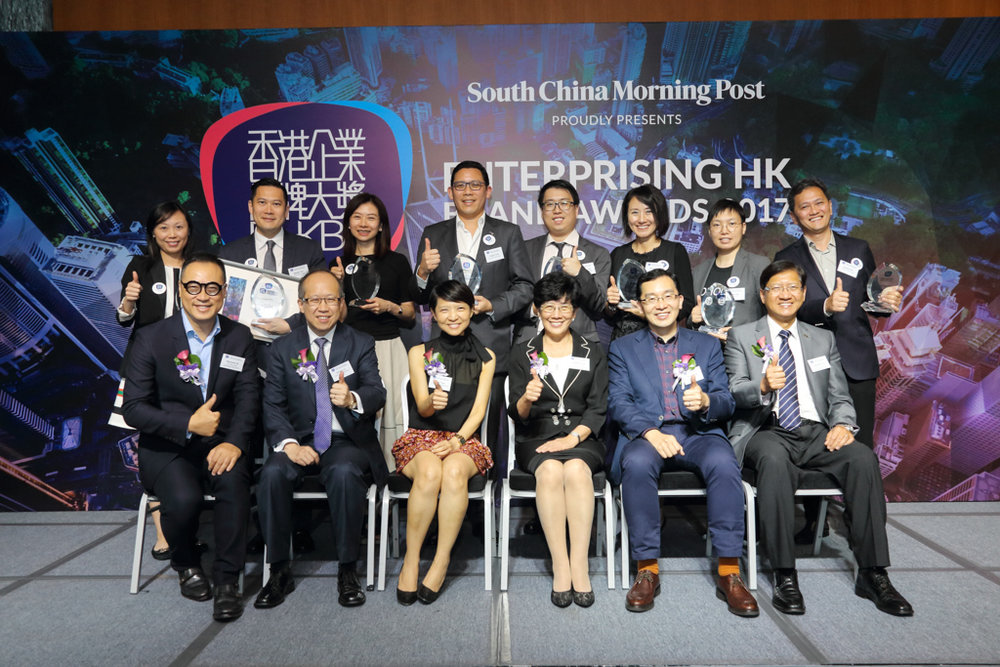 The Enterprising Hong Kong Brand Awards 2017 winners include (back row, left) Ms Kathy Tang, Customer and Brand Engagement Manager of CLP Power Hong Kong Ltd; Mr Stanley Kan, Director, Service Delivery of Hong Kong Airlines; Ms Winnie Ho, Head of Branding and Marketing Communications of 3 Hong Kong; Mr Fergus Fung, Executive Director of Lan Kwai Fong Group; Mr Bismarch Chen, CRM Manager of German Pool O2O Limited; Ms Belinda Au, General Manager, Distribution and Marketing of Sun Life Financial; Ms Aries Lee, Founder and CEO of HOHOLIFE and Mr Sammy Kam, Technical Director of Octopus Cards Limited.  The Awards are supported by an esteemed judging panel including (front row, left) Mr Raymond Ho, Chairman of The Hong Kong Advertisers Association; Mr Gordon Lo, Director, Business Management of Hong Kong Productivity Council; Ms Irene Yuen, Marketing Director, Brand Marketing of South China Morning Post Publishers Limited; Prof. Angelina Yuen, Vice President (Student and Global Affairs) of The Hong Kong Polytechnic University; Dr Edmund Lee, Executive Director of Hong Kong Design Centre and Mr Raymond Yip, Deputy Executive Director of Hong Kong Trade Development Council.