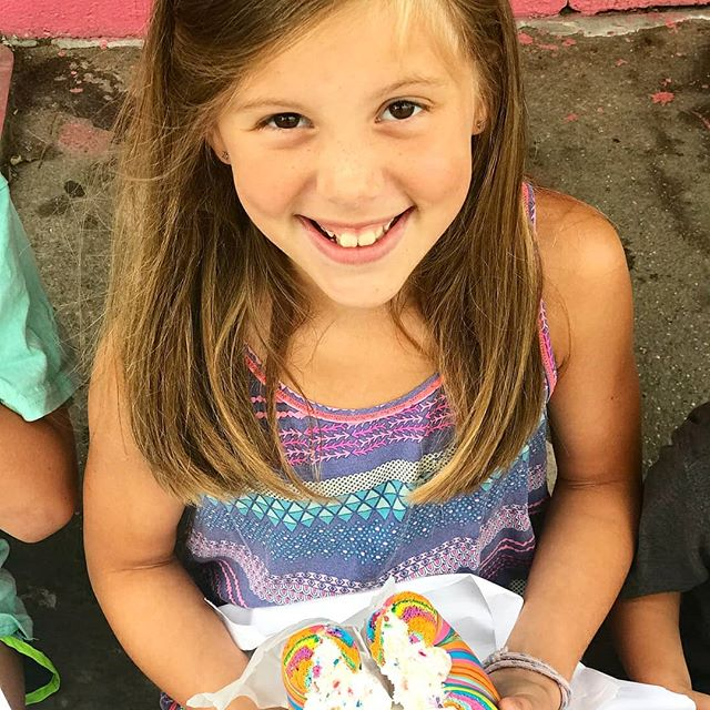 That Original Rainbow Bagel smile that lasts for miles! 🌈😍 Never gets old -Thanks to 📸 @coleyberry And Family for this 🌈 #thebagelstore #originalrainbowbagel #rainbowbagel #foodporn #forkyeah #nyceats #eatfamous #eeeeeats #foodporn #myfab5 #familyvacation #eatfamous #smiles #lovewins #itsallaboutthekids