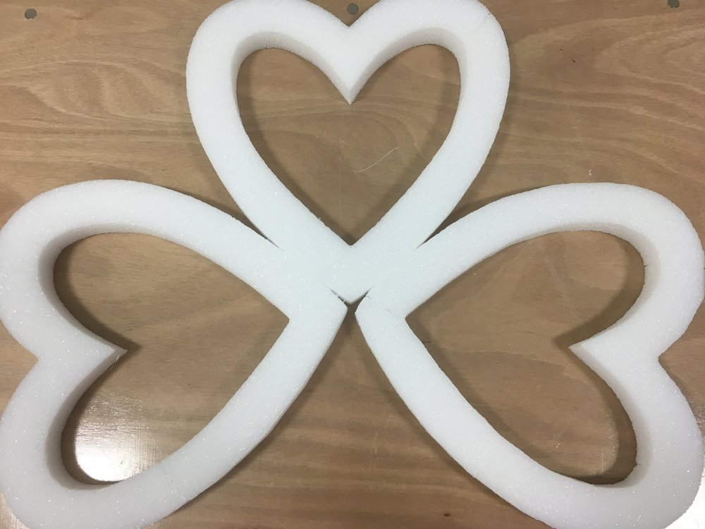 Step One: - Place your 3 foam hearts together to shape a 3 leaf clover. Secure by hot glueing the pieces together.