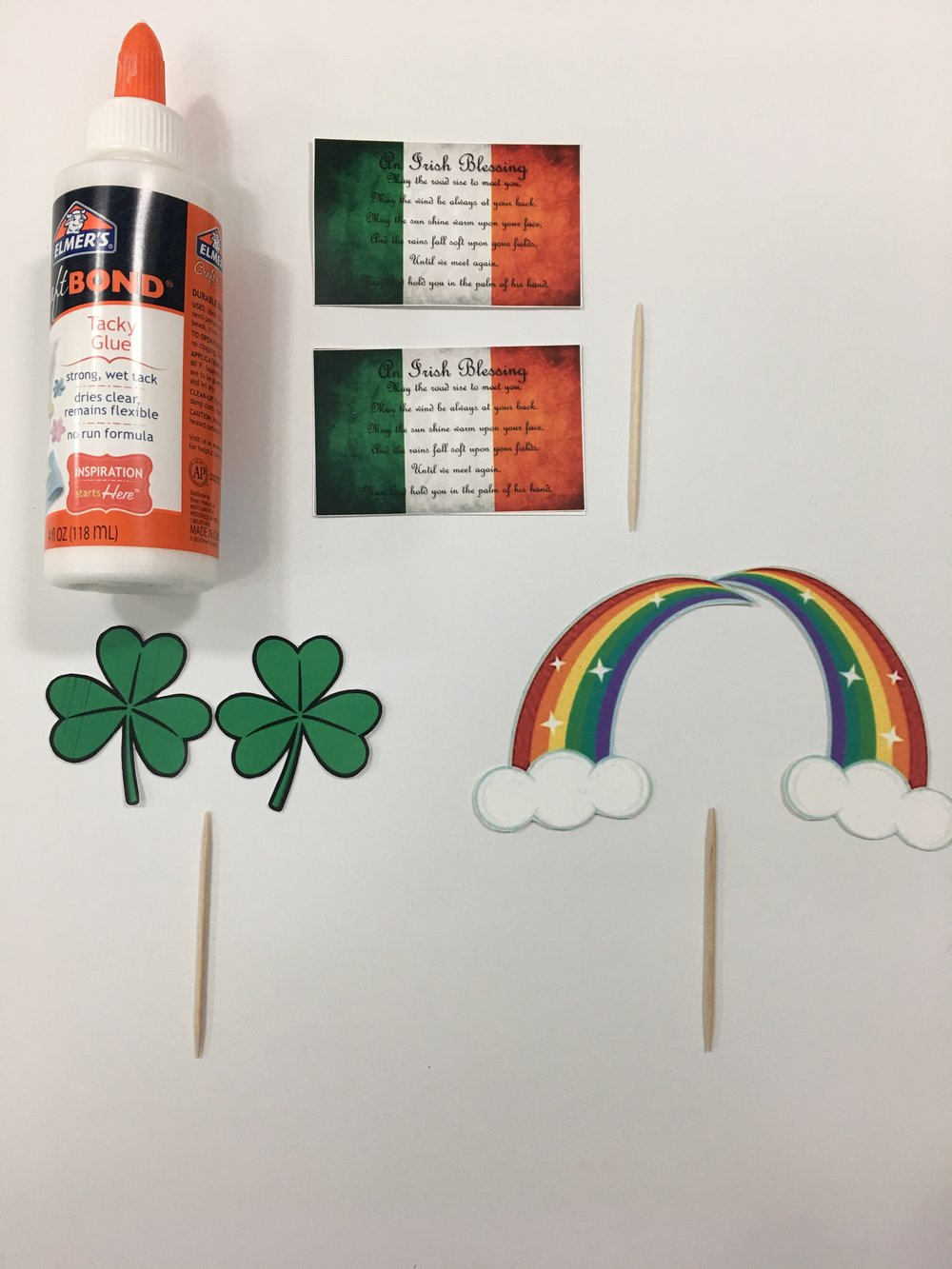 Step One: - You have the option to paint your toothpicks, or leave them plain. I opted to not paint. Print and cut out your images. Then glue them to the toothpicks.DIY TIP: To personalize, before you print, you can add a name, quote, or saying to the flag tag. For this project I decided to add the Irish Blessing. :)