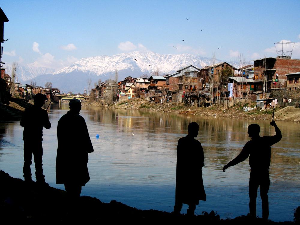 Young men fishing in Srinagar, India