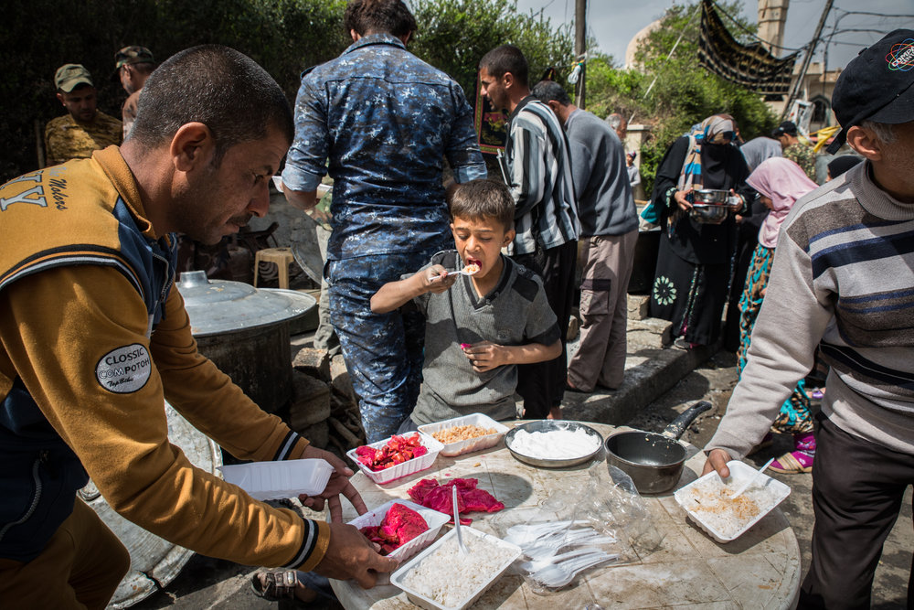 Civilians receive food aid in west Mosul