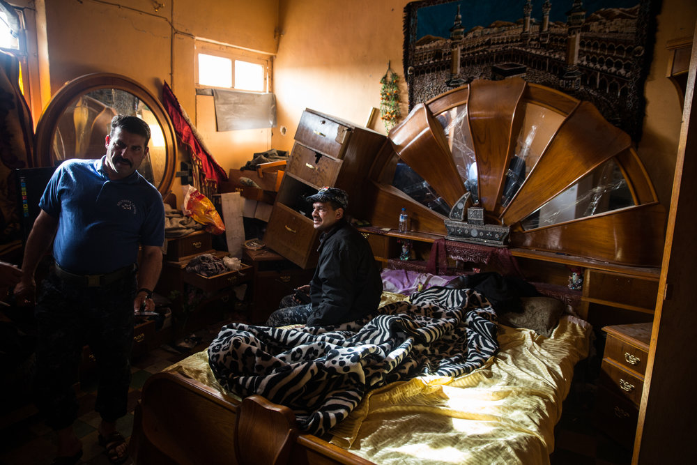 Federal Police commanders shave and rest in a civilian home on the front line in west Mosul