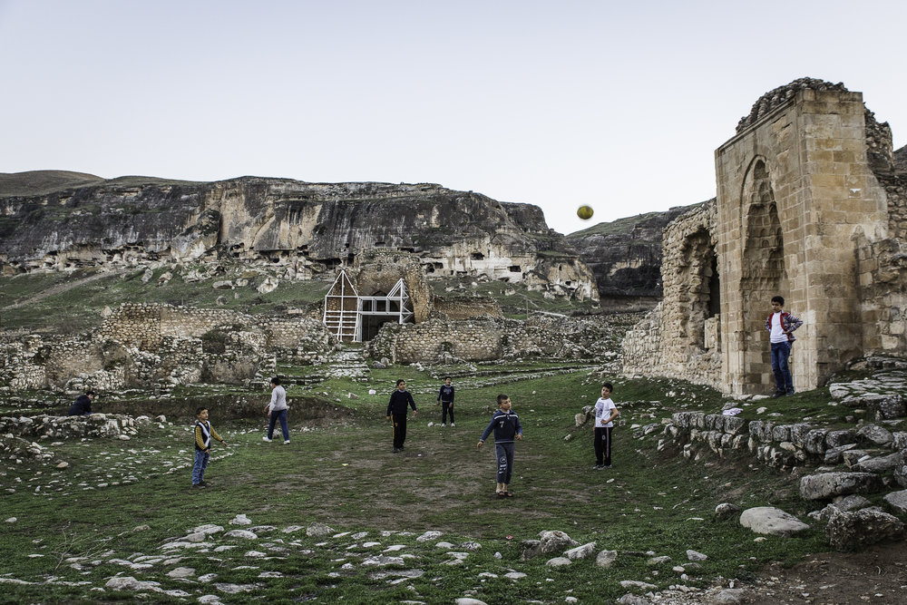 Children play soccer near Ayyubid mosques in Hasankeyf. Many residents of Hasankeyf were christian until the last several decades, when they converted or moved away.