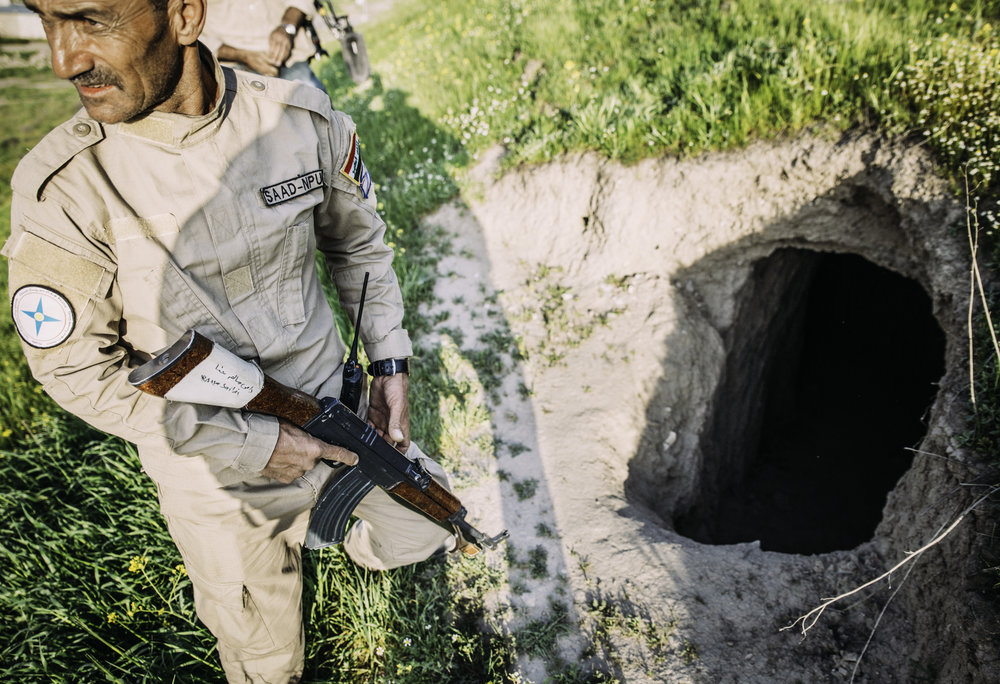 A member of the Nineveh Protection Unit, the Christian militia, stands by an Islamic State tunnel dug beneath a church.