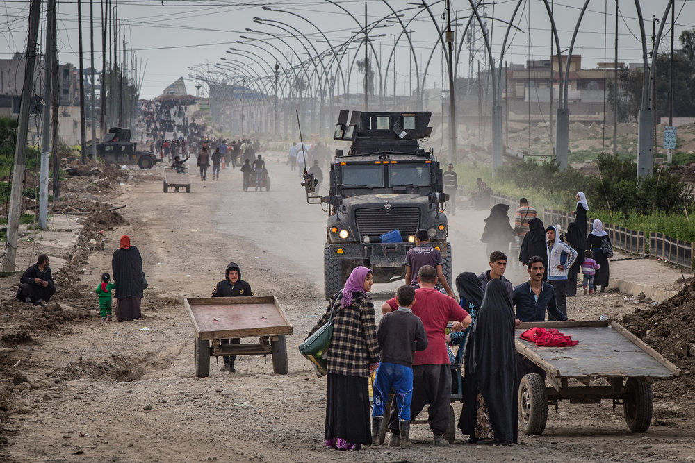 Civilians flee from fighting in west Mosul