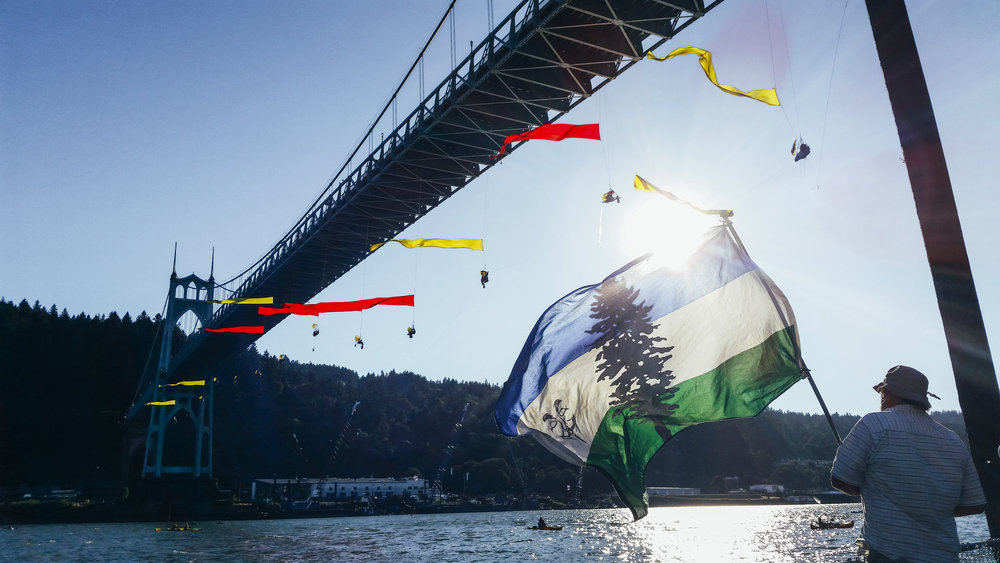 Greenpeace protesters hang from the Saint Johns Bridge it Portland, Oregon to block the passage of Shell Oil's icebreaker MSV Fennica.