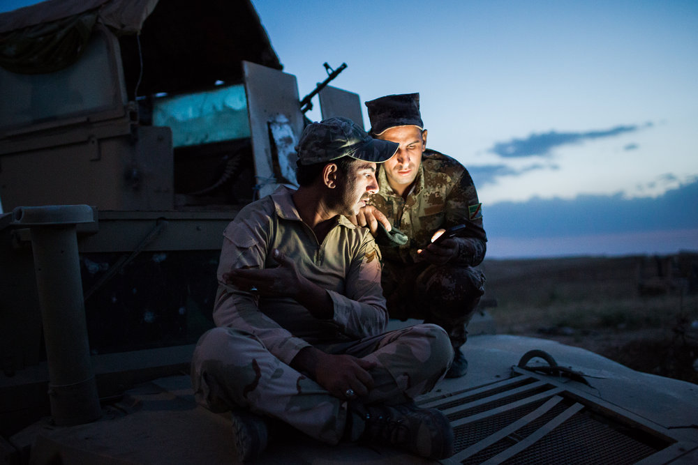 Iraqi soldiers from the 9th Armored Division connect with the outside world while on the front lines in Musharrifah.