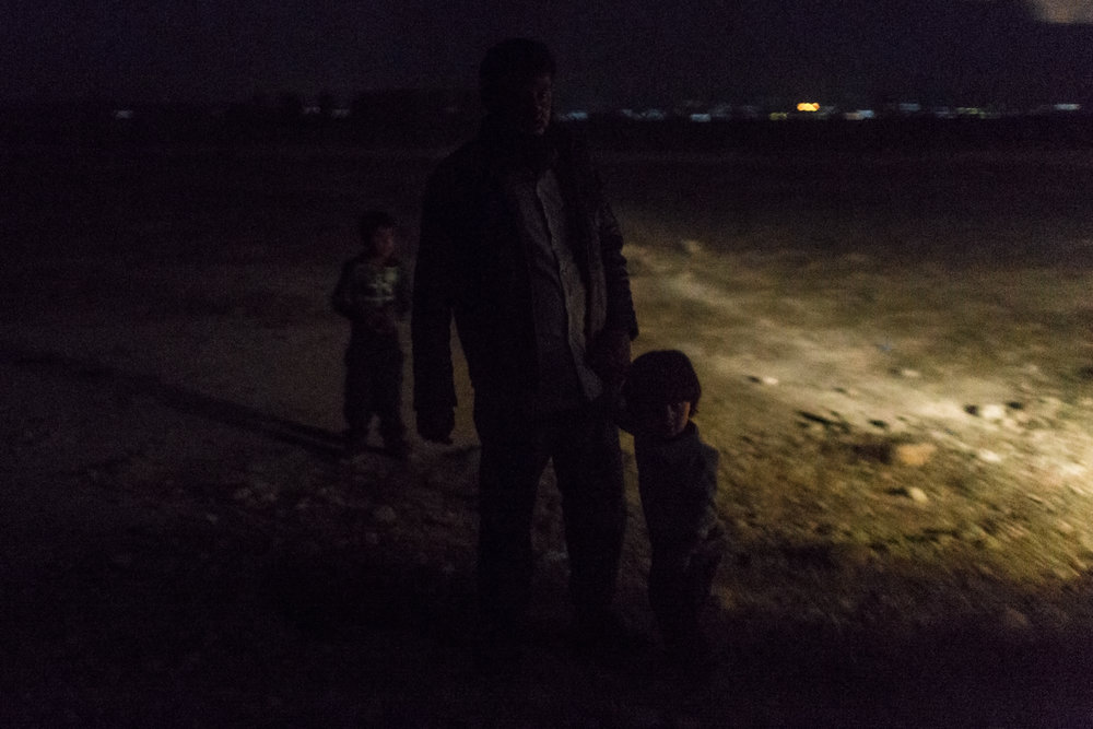 IDPs arrive at the transfer point under the cover of darkness.