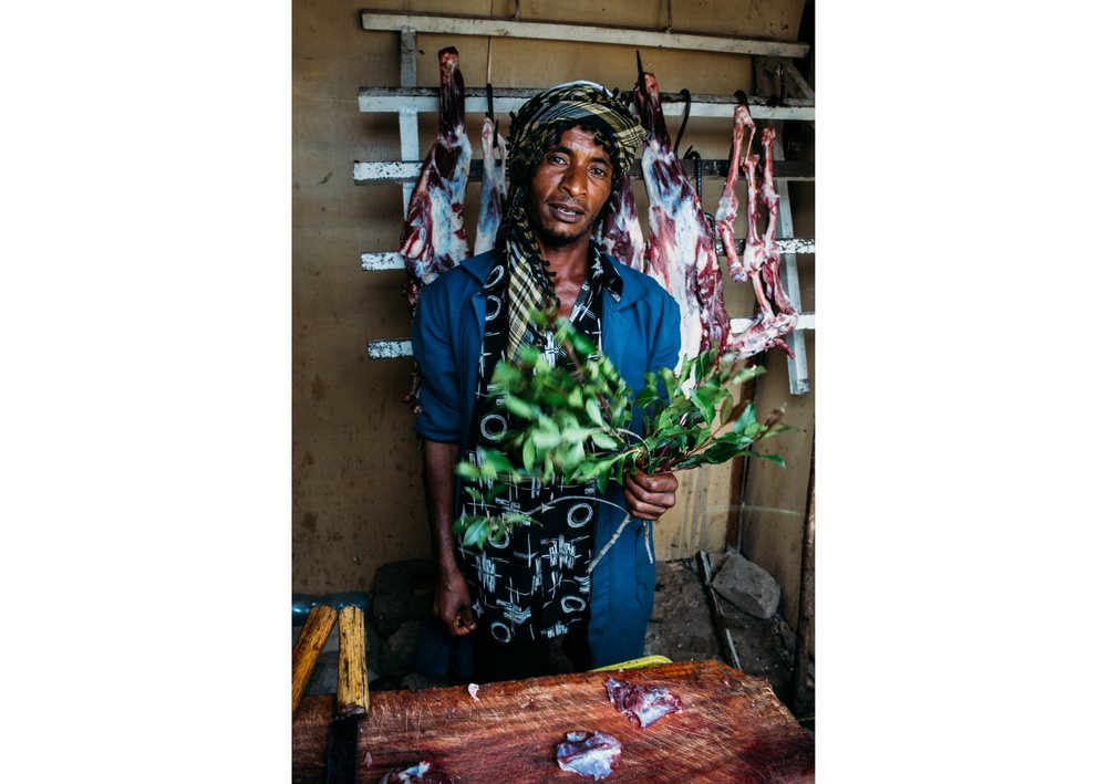 butcher with khat - between Gambela and Addis Ababa, Ethiopia