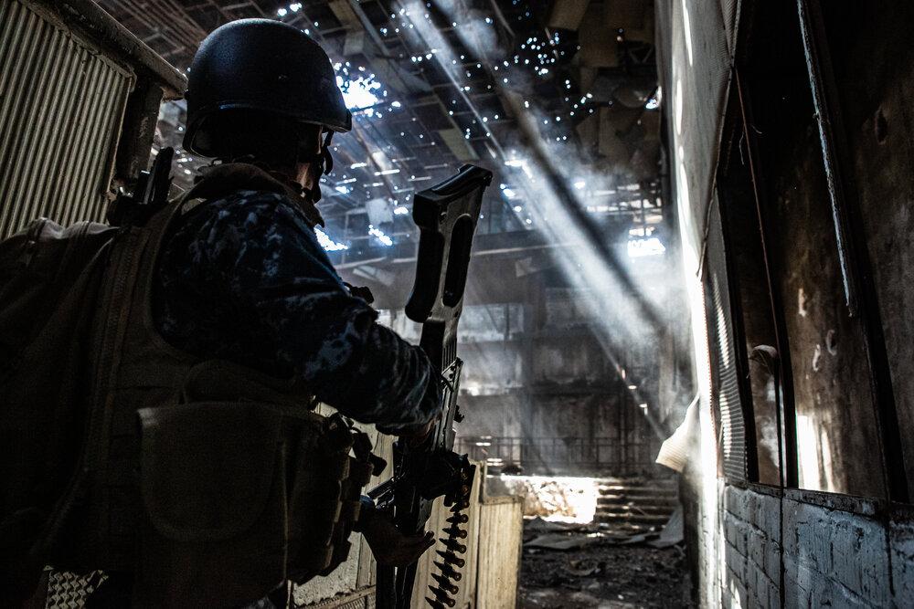 Federal Police enter a cinema in west Mosul