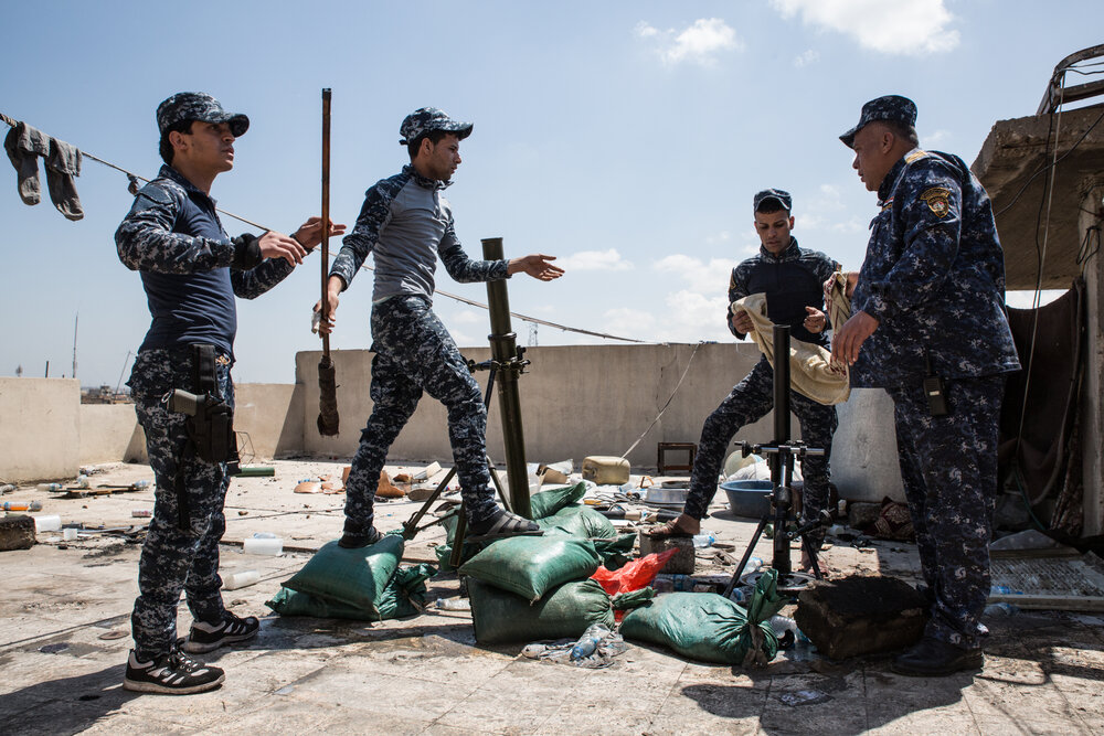 A Federal Police mortar team maintains their position on the front lines in the Old City.