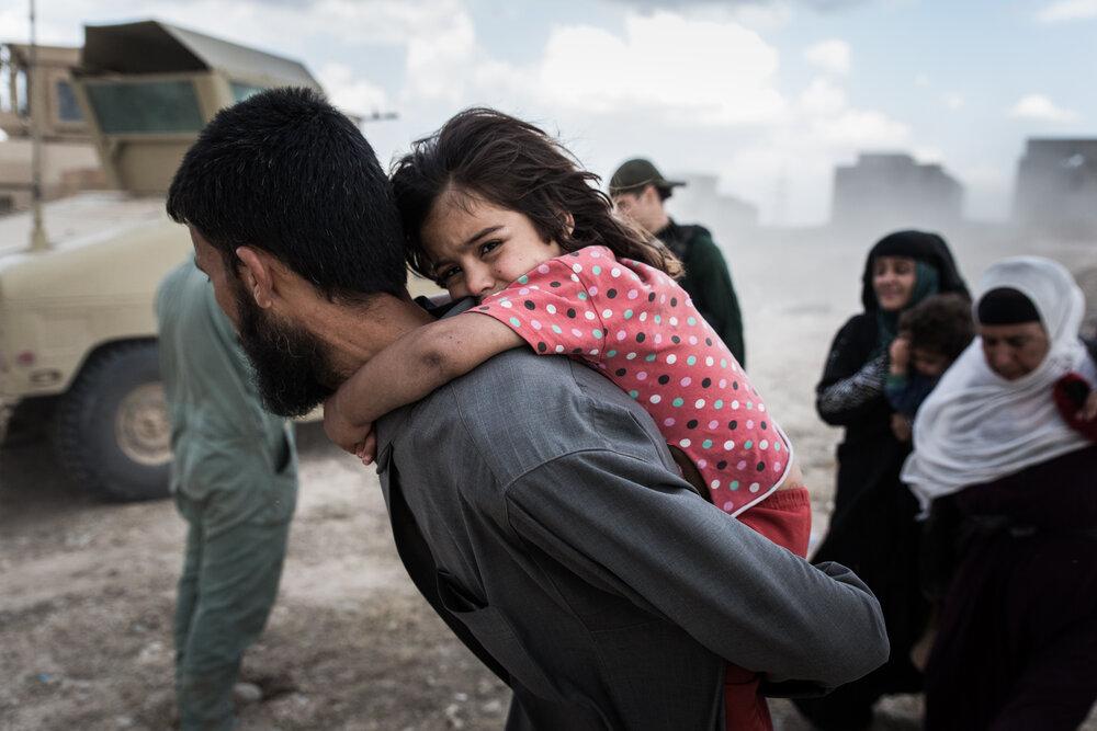 Civilians fleeing battles in Musharrifah, northwest Mosul.