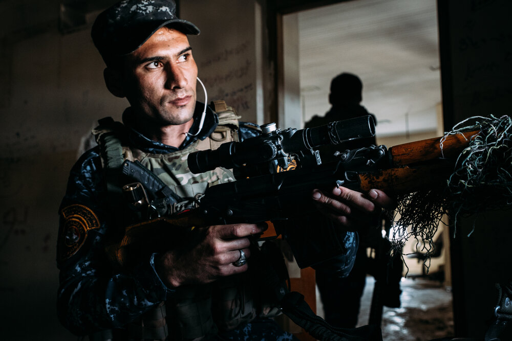 A Federal Police sniper watches over west Mosul