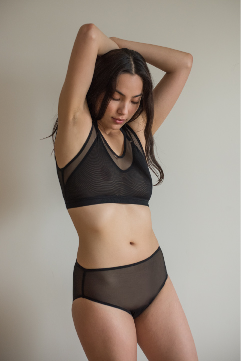 The Crop Top. Pictured in black. Available in black, light pink, pop, blue or grey.