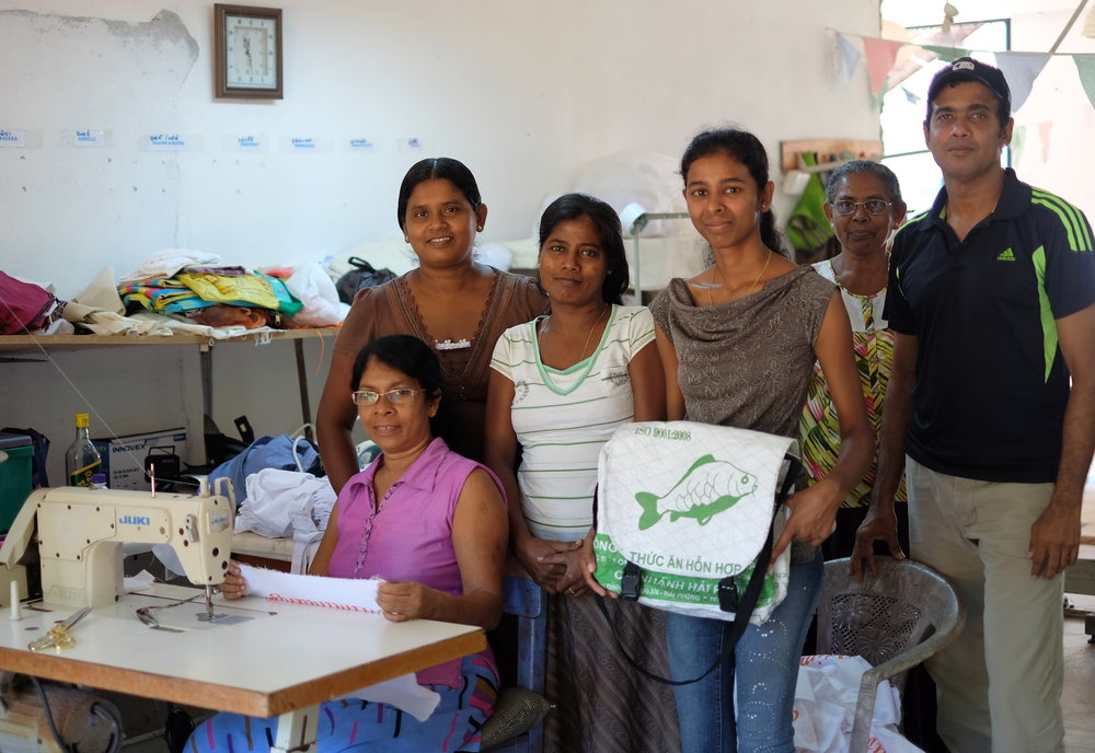 Nikeshala (in the middle) presenting her own design to the people working at Manacare Foundation.