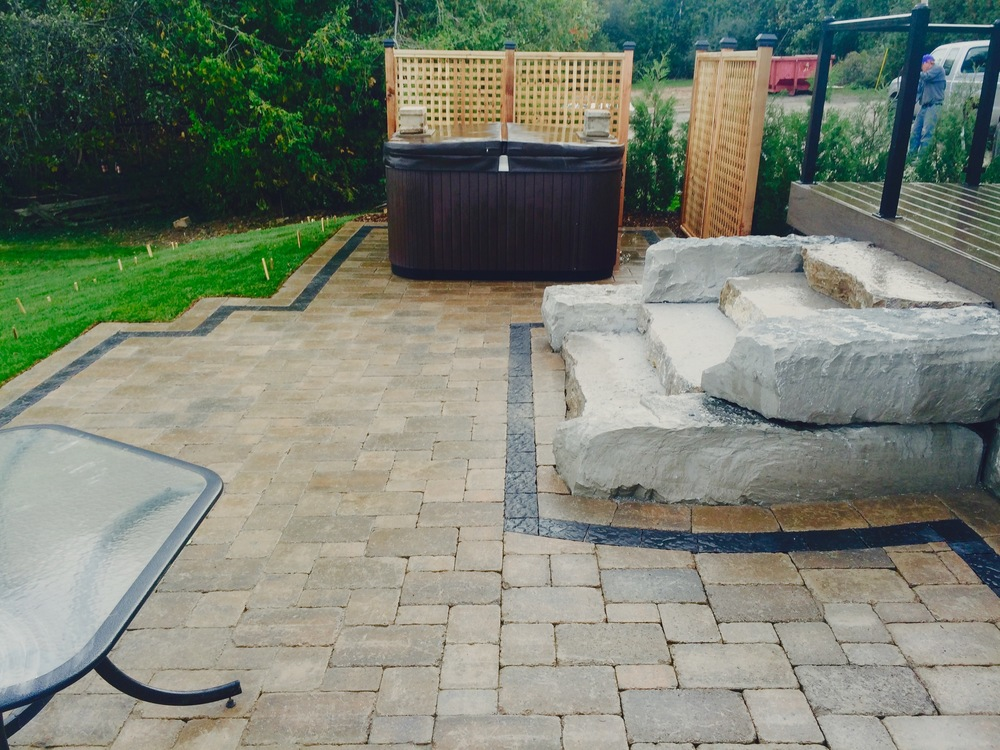 New Patio With Privacy Lattice And Armour Stone Steps