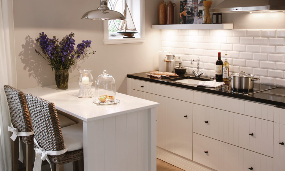 Well-appointed and snug - the open-plan kitchen with a counter - the perfect breakfast bar for two
