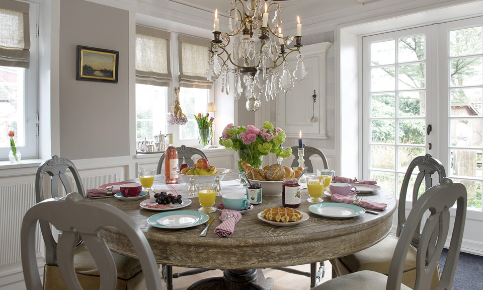Enjoy a relaxed and sophisticated breakfast under a painted ceiling