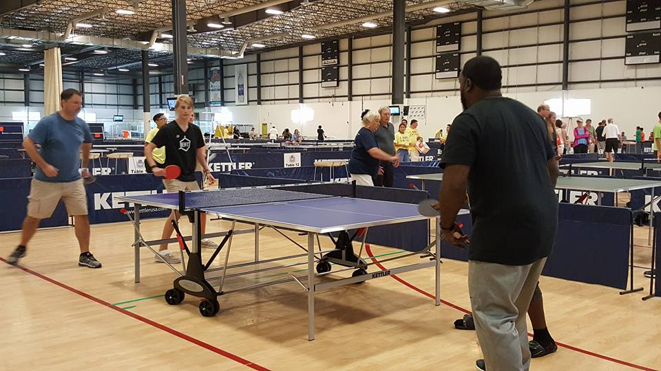 Jim and Ryan Setzer at the Virginia Beach Field House playing ping pong.