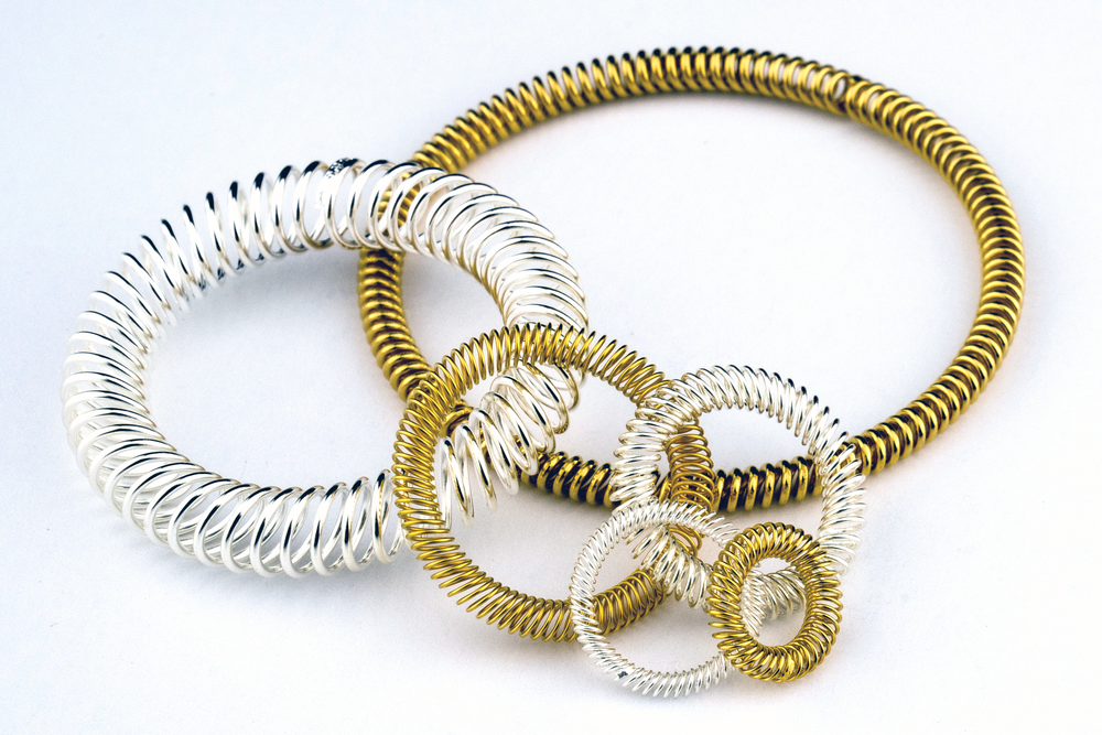GOLD AND SILVER PLATED DYNAFLEX™ CANTED COIL SPRINGS