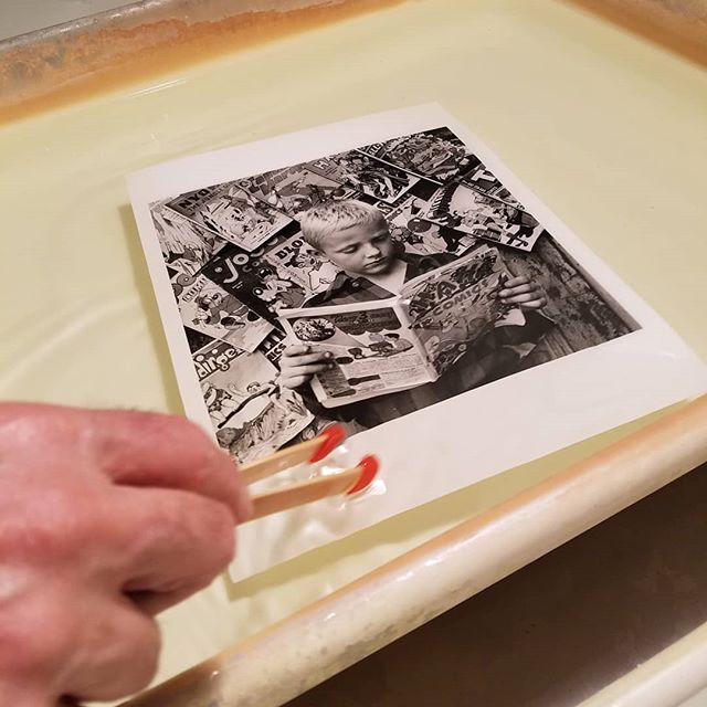 "The final fiber print of Morris Engel's ""Comic Book Reader"". See what it looked like in the enlarged by checking out our Instagram story!  #chelseaphotographicservices #chelseaphotographic #nycdarkroom #silvergeltinprints #darkroomprinting #handmade #MorrisEngel #traditionaldarkroom #newyorkfilmphotographers #filmphotography #deathtodigital #filmisalive #filmcommunity #analogphotography"