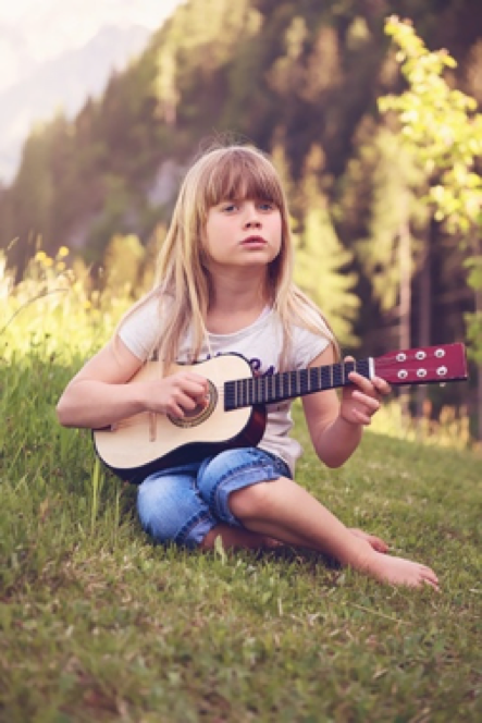 kid playing guitar