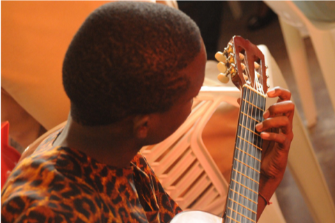 western child playing guitar
